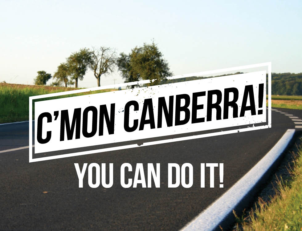 A country road scene with text overlay that reads 'C'mon Canberra, you can do it!'