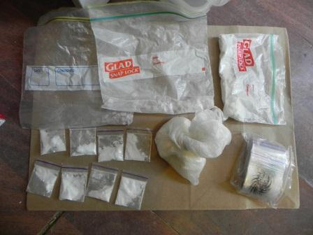 Plastic zip lock bags containing white powder & crystals believed to be drugs