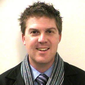 Image of Stuart Heddle, 39-year-old male, described as 6' tall (183cm), Caucasian, short dark brown hair and light brown eyes with a thin build