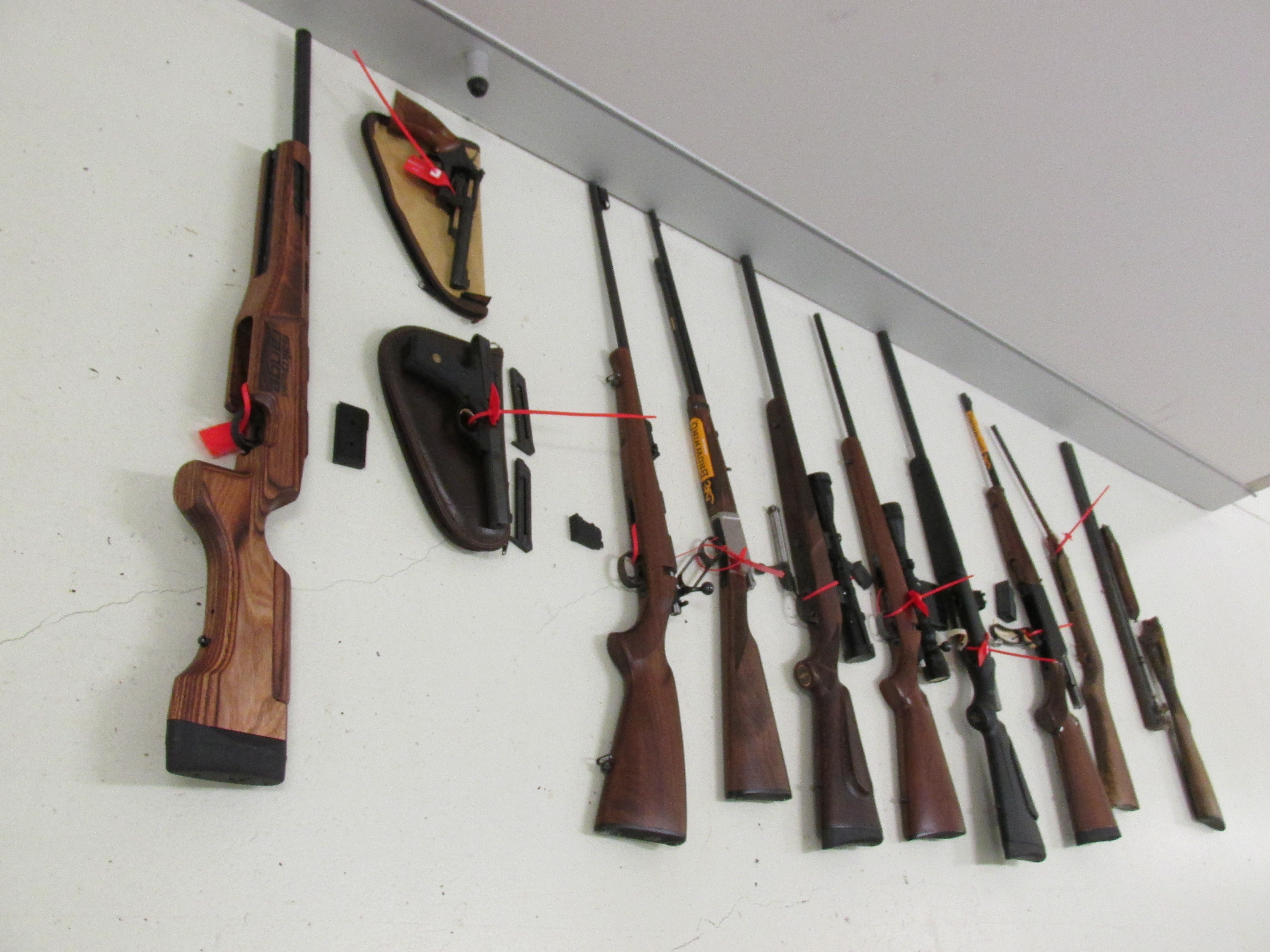 Seven rifles, a revolver, a pistol, a double barrel shotgun along with in excess 3,000 rounds of ammunition and an amount of gun powder