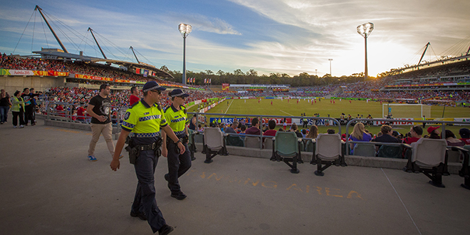 Police patrol the grounds at the Asian Cup