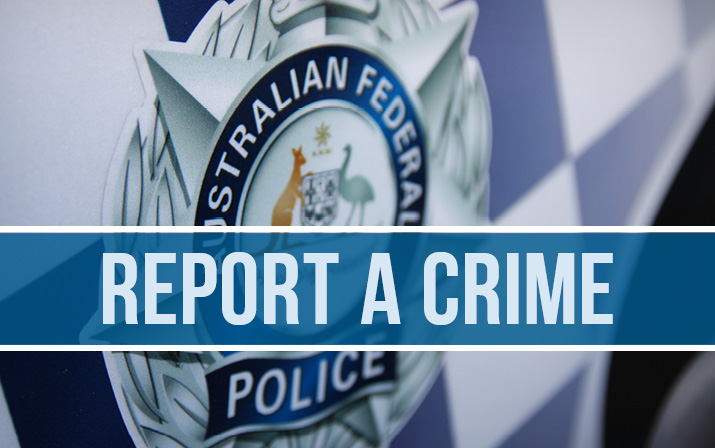 Image of AFP police badge on a chequered background with the words Report a Crime