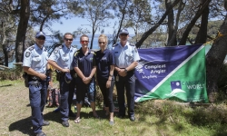 Jervis Bay Officers Sergeant Stephen Szabo, Leading Senior Constable Scott Burger and Senior Constable Scott Vandervalk with AFP member Mardi Grundy and Compleat Angler & Camping World Nowra sponsor, Steve Flanagan.