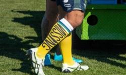 Raiders wearing missing persons socks for web.jpg