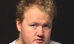 Image of Garry Gordon, 25 year old male, wearing white T-shirt