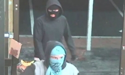Two male offenders described as Caucasian, around 6' tall (183cm), wearing black hooded jumpers with their faces covered, one using a balaclava and the other a T-shirt.