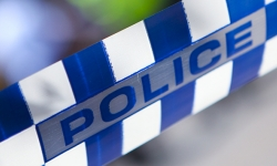 image of blue and white chequered police tape