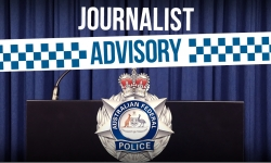 Image of a lecturn with AFP badge on the front with the words journalist advisory